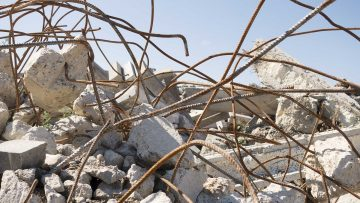Pieces of broken concrete and curved metal rods